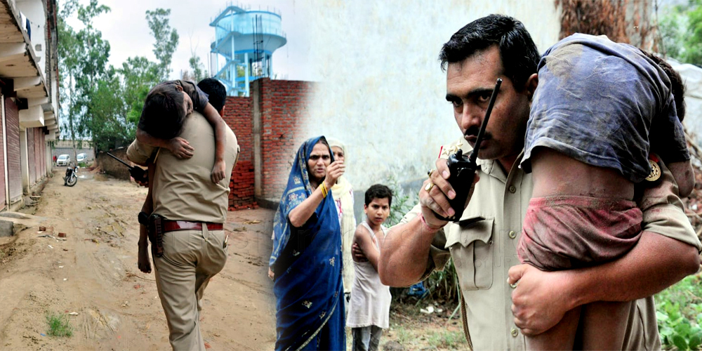 Cop Dharmendra Lamba saved child life Took on shoulder in building collapse