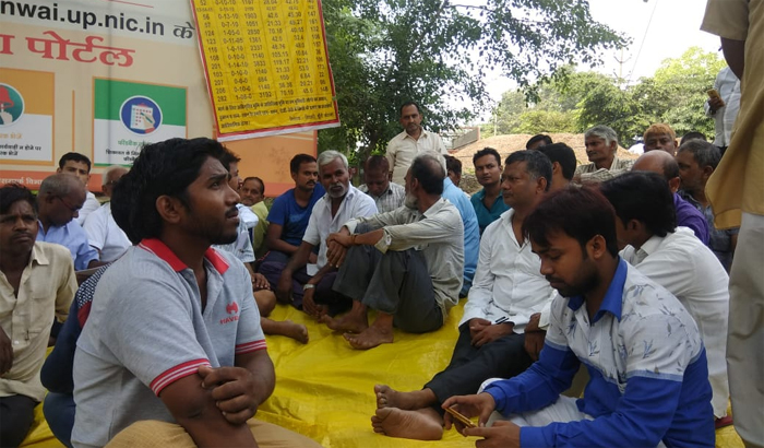 Allahabad: People sitting on protest against Subversion by ADA