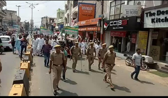 foot march by RLD workers, protest against inflation